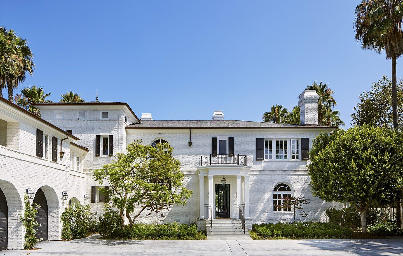 Adam Hunter designed white brick home in Brentwood park.
